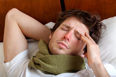 Man having a flu. Man lying in bed with a flu Royalty Free Stock Image
