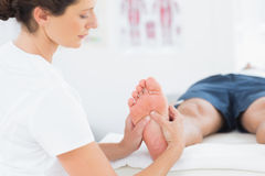 Man having foot massage Royalty Free Stock Photos