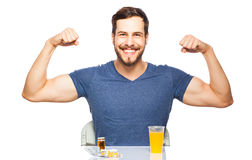 Man having in front pills and orange juice Royalty Free Stock Photo
