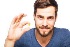 Man having in front pills and orange juice Stock Image