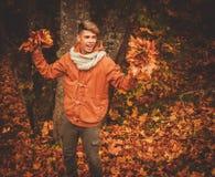 Man having fun in autumn park Stock Photos