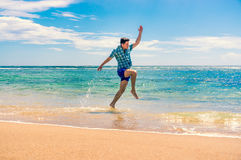 Man having fun at the beach Stock Photos
