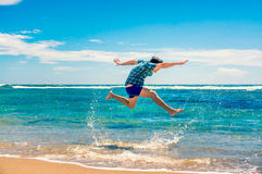 Man having fun at the beach Stock Photography