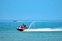 Man having fun in jet ski at Gulf Florida Beaches. royalty free stock photography