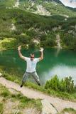 Man Having Fun on Mountain Royalty Free Stock Photography