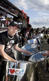 A man having fun and playing steel drums Royalty Free Stock Photos