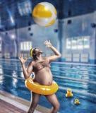 Man having fun in pool Royalty Free Stock Images