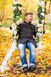 Man Having Fun On Swing In Autumn. Man Having Fun On Woodland Swing In Autumn Stock Photos