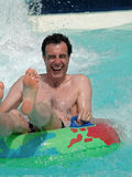 Man having fun at waterpark. Natural portrait of man laughing at waterpark royalty free stock photography