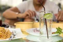 Man having glass of fresh sparkling mineral water. With his dinner Stock Images