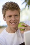 Man Having Green Apple Royalty Free Stock Images