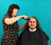 Man having an haircut Royalty Free Stock Photography