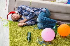 The man having hangover after christmas party Royalty Free Stock Image