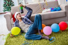 The man having hangover after christmas party Royalty Free Stock Photography