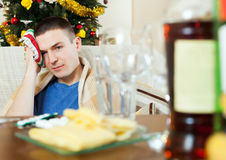 Man having hangover after   New year party Stock Photo