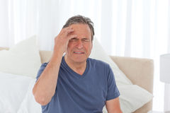 Man having a headache Royalty Free Stock Image