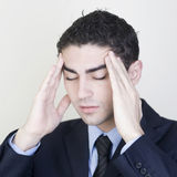 Businessman with headache. Man having headache on white background royalty free stock photos