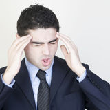 Businessman with hangover. Man having headache on white background stock photography