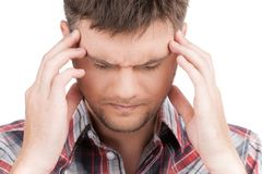 Man having headache on white background. Royalty Free Stock Images