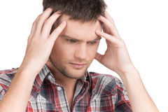 Man having headache on white background. Royalty Free Stock Image