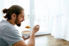 Man Having Healthy Breakfast At Home royalty free stock photos