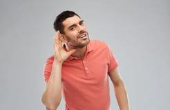 Man having hearing problem listening to something Royalty Free Stock Photos