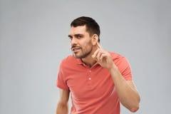 Man having hearing problem listening to something Royalty Free Stock Images