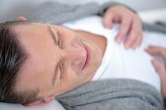 Man having heart attack Stock Photo
