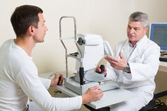 Man having his eyes examined by an eye  elderly Royalty Free Stock Image