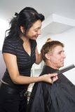 Man having his hair styled royalty free stock photography
