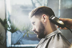 Man having his hair trimmed stock photos