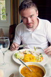 Man having his meal Stock Photo