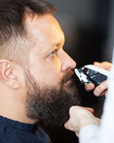 Man having his mustache trimmed at a barber stock photography