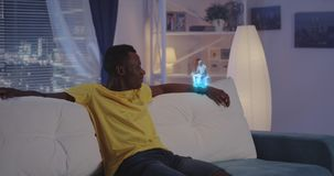Man having holographic video call