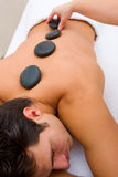 Man having hot stone massage Stock Photo