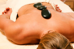 Man having a hot stone therapy session Royalty Free Stock Photography