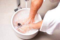 Man having hydrotherapy water footbath Stock Image