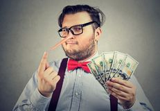 Man having illegally earned money royalty free stock images