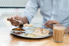 Man having Indian meal. At cafeteria Stock Images