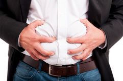 Man having indigestion after a business lunch Stock Photography