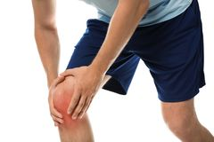 Man having knee problems on white background. Closeup royalty free stock images