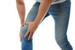 Man having knee problems on white background. Closeup stock photo