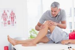 Man having leg massage Royalty Free Stock Photography