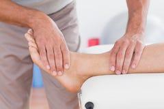 Man having leg massage Stock Photos