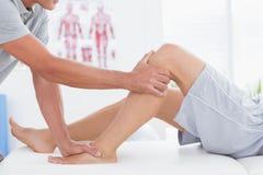 Man having leg massage Stock Photo