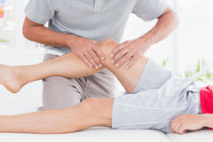 Man having leg massage Royalty Free Stock Photos