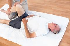 Man having leg massage Stock Photography