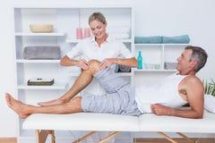Man having leg massage Stock Images