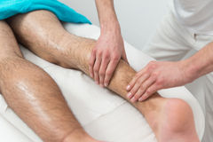 Man Having Legs Massage In A Spa Center Stock Images