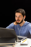 Man having on line lessons through the internet. Royalty Free Stock Image